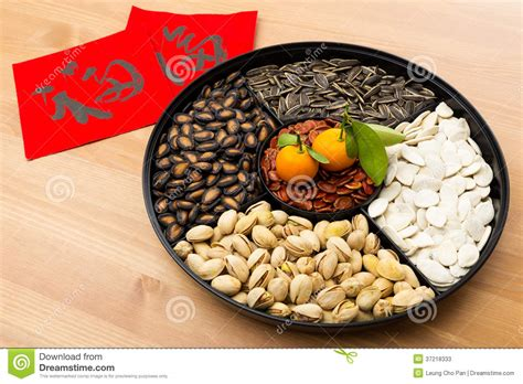 new year snacks meaning new year snack tray and calligraphy