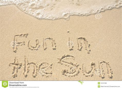Fan Sanden in the sun written in sand on stock photo