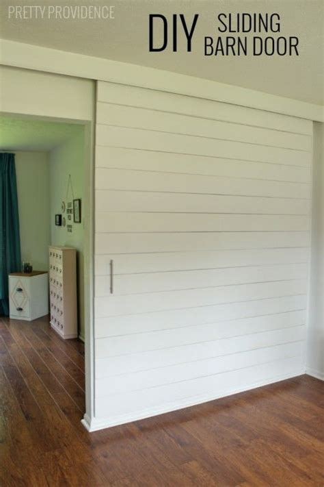 How To Make A Rolling Barn Door 35 Diy Barn Doors Rolling Door Hardware Ideas Barn Doors Hardware And Barn