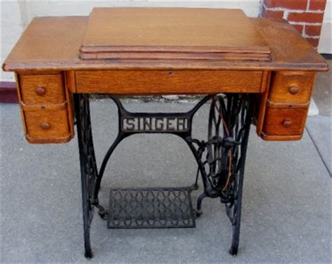 antique singer treadle sewing machine in cabinet with
