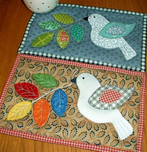 the patchsmith winter dove and russian doll mug rugs