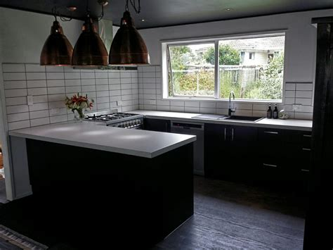 kitchens with black bench tops fine white kitchen black benchtop quartz engineered stone