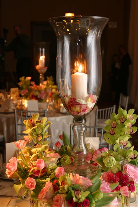 wedding centerpieces with candles and roses 2 weddings on a budget 15 quot footed hurricane vases