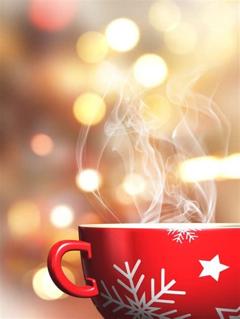 coffee christmas wallpaper steaming christmas mug on a bokeh lights background photo
