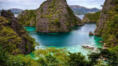 Ocean beach tropical cliffs philippines islands boats