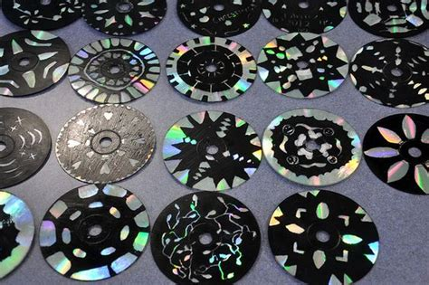 acrylic paint for scratch designs on a cd black acrylic paint then scratch design