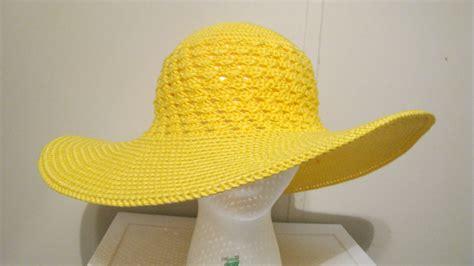 yellow hat pattern enjoying a few moments of crocheting a summer beach hat