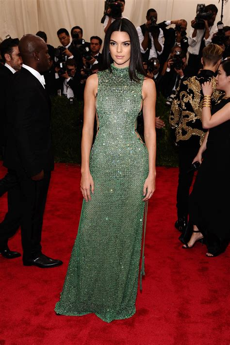 kylie jenner 2015 met gala kendall jenner in a green beaded calvin klein collection