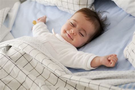lying on bed smiling baby lying on a bed photo free download