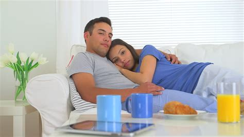 snuggling on the couch cute mexican couple cuddling on couch stock footage video
