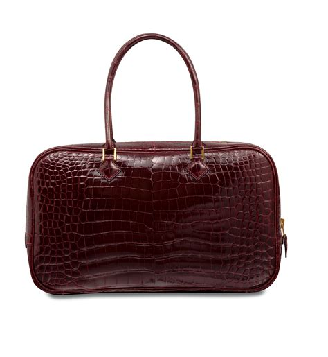 Plume Bag From Mad Imports by Shiny Bordeaux Porosus Crocodile Plume 200 Lan Bag With Gold