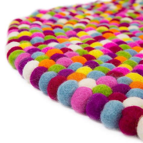 runder lila teppich runder bunter pom pom teppich cult furniture uk
