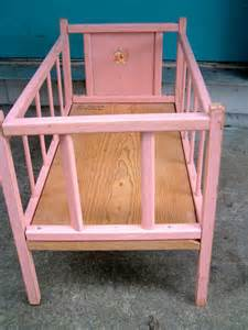 vintage pink wooden doll crib