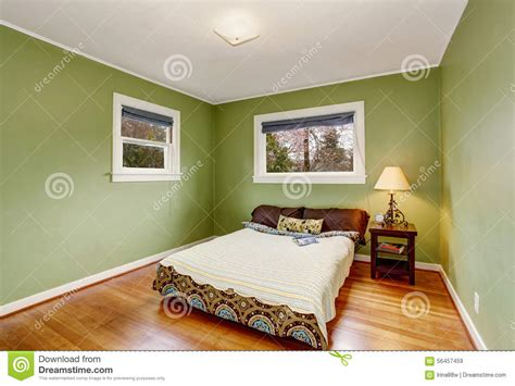 green theme bedroom boho themed bedroom with green walls and hardwood floor stock photo image 56457459