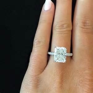 Diamond engagement ring besides black swarovski crystal earrings as