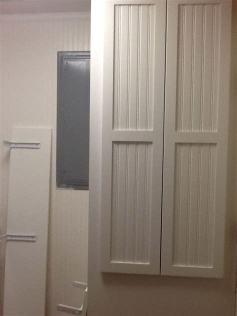 how to cover paneling electric panel and a c cover up interior design pinterest