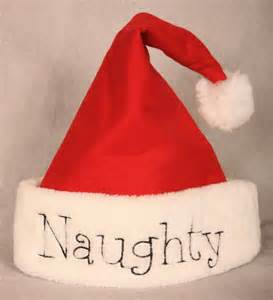 Cupcake Accessories For Kitchen - naughty or nice santa hat stuck on stitches