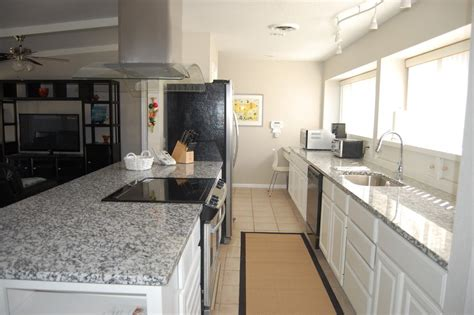 pearl granite with white cabinets pearl granite kitchen transitional with stainless