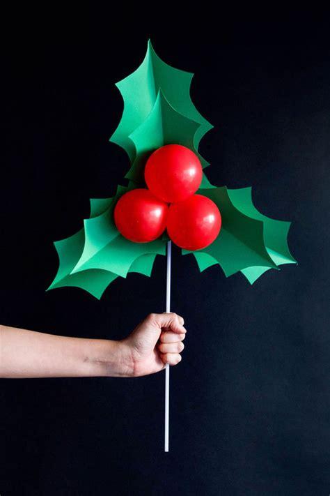 Cheap Christmas Centerpieces To Make - holly balloon sticks