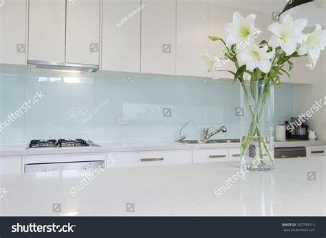 white kitchen bench flowers on white kitchen bench splashback stock photo 167790515 shutterstock