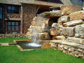 Garden landscaping designs with big rocks can add past and modern