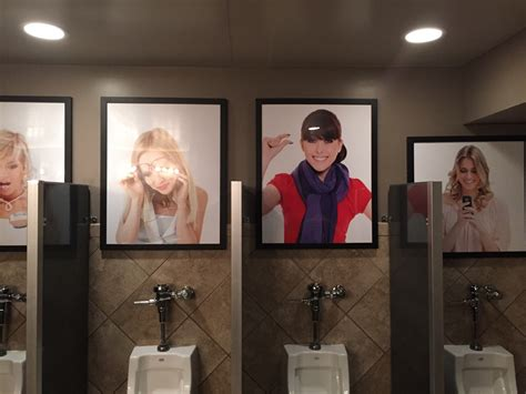 public bathroom fun pictures above the urinals at a bar funny