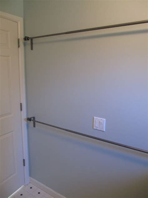 laundry room hanging rod use stacked curtain rods in laundry room to hang clothes or to air clothes