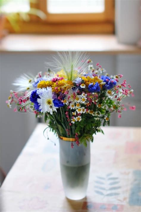 flowers on table vase of wild flowers on table stock photo colourbox