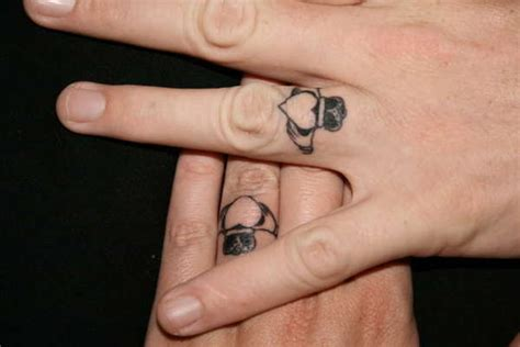 tattooed couple wedding 25 slick wedding ring tattoos creativefan