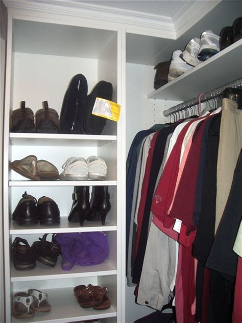 this custom closet system has built in drawers and shelves