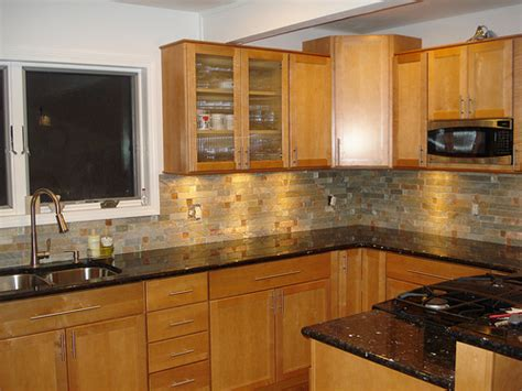 Countertops For Oak Cabinets by Granite Countertops And Oak Cabinets