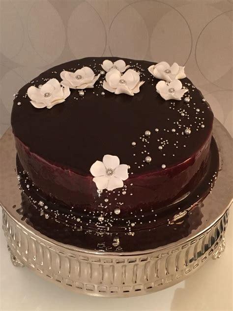 mirror glaze cake sponge cake covered by a chocolate mirror glaze i was so