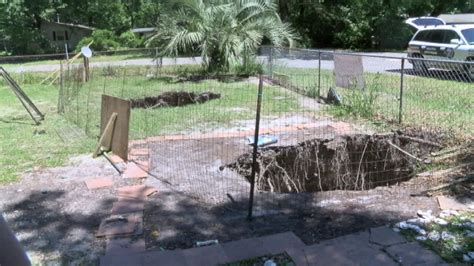 small sinkhole in backyard two sinkholes open up tallahassee family s front yard
