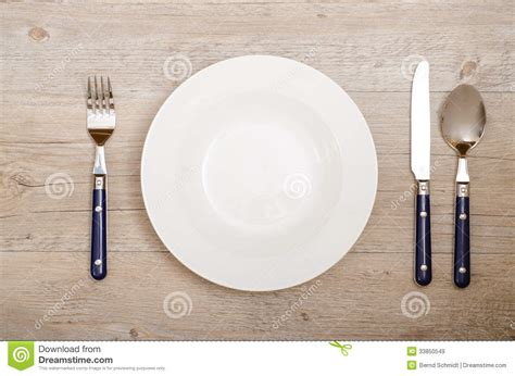 restaurant table top covers cover with knife fork and spoon on a dining table stock