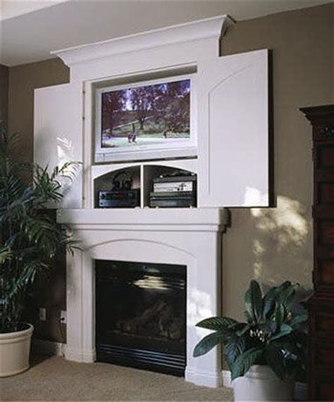 above fireplace tv hideaway the idea of being able to