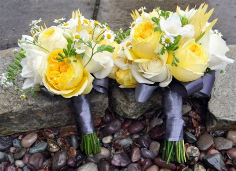 bridesmaid and wedding bouquets in yellow white and grey yellow wedding flowers