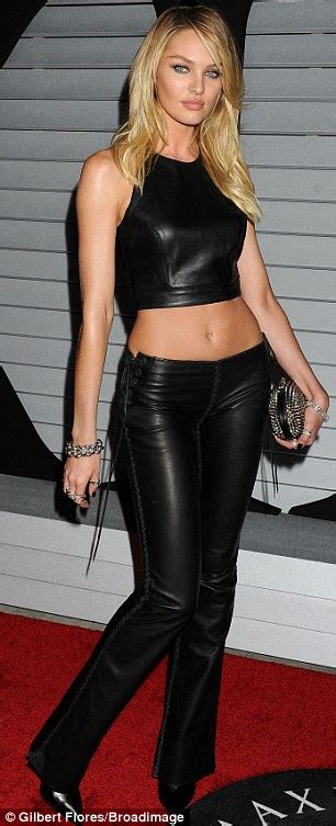 Candice Swanepoel shows off stunning figure in leather backless crop top and trousers at Maxim