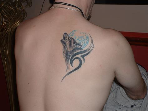 tribal back and shoulder tattoos tribal and wolf on right back shoulder