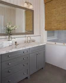 Grey cabinetry in bathroom tiled walls