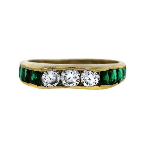 14k yellow gold three and emerald ring boca