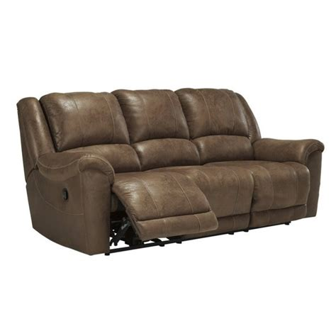 ashley reclining sofas ashley niarobi faux leather reclining sofa in saddle 4060188
