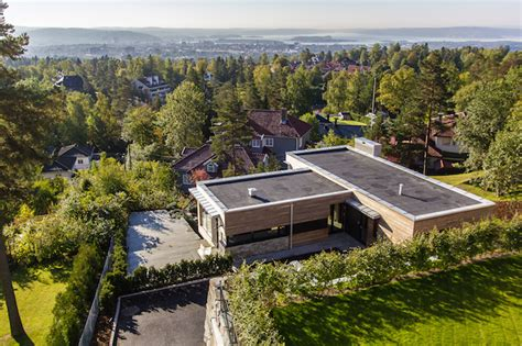 luxury villa melkeveien is wrapped in sustainably sourced