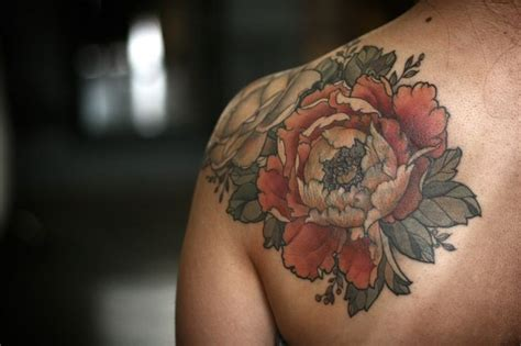 coloured flowers on shoulder by kendall