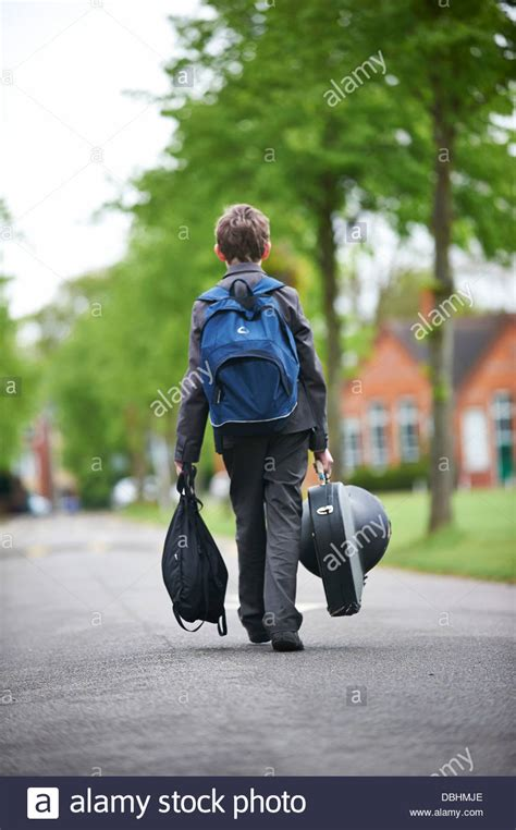 boy walking home from school stock photo royalty free