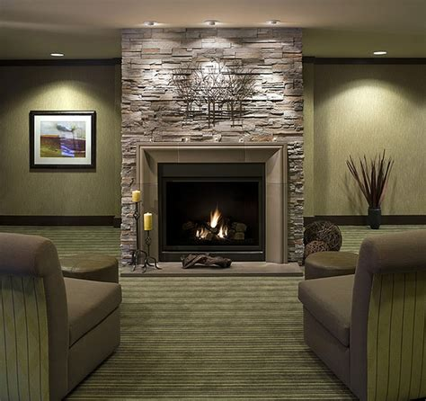 Fireplace Wall Ideas | black wood burning fireplace design idea with gray stone