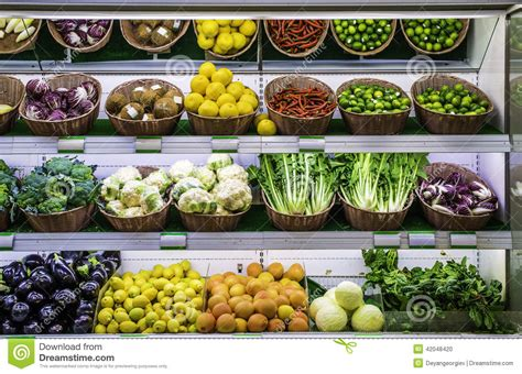 Shelf Of Oranges by Fruits And Vegetables On A Supermarket Stock Photo Image