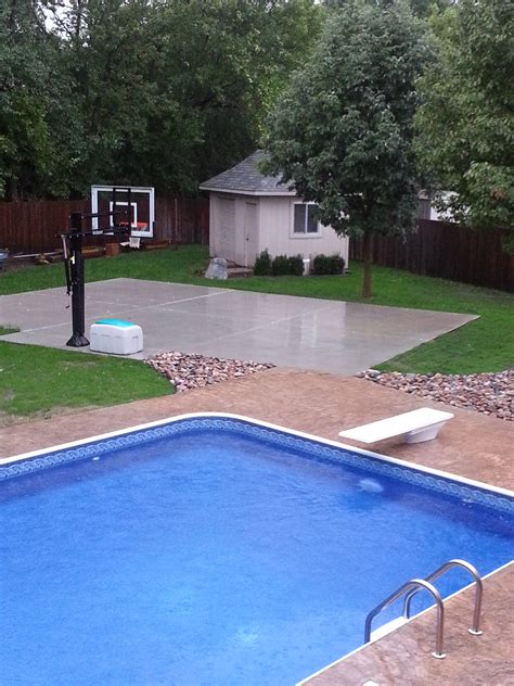 backyard pool and basketball court in the background you can see his pro dunk silver