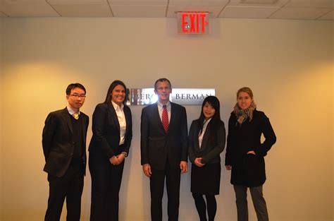 Uo Mba Candidates with professor chalmers at neuberger berman uo