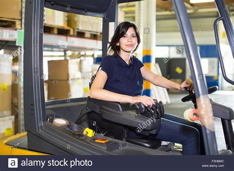 portrait of forklift truck driver working in distribution stock photo royalty free image