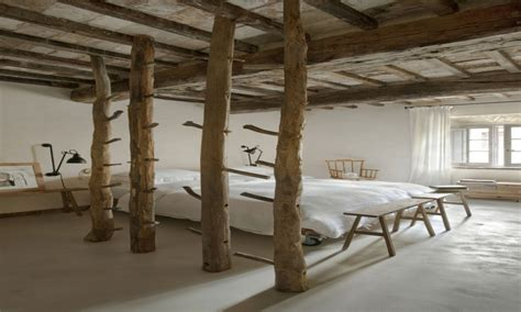 exposed ceiling beams and wooden pillar rustic bedroom